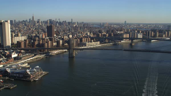 Flying Over East River And Brooklyn Bridge Looking Toward Midtown Manhattan Shot In 2011 Stock Footage