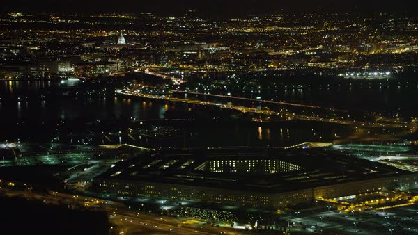 High View Of The Pentagon At Night With Washington Dc Across Potomac