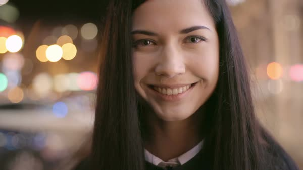 Video portrait of beautiful young woman smiling at camera and lowering her eyes Royalty-free stock video