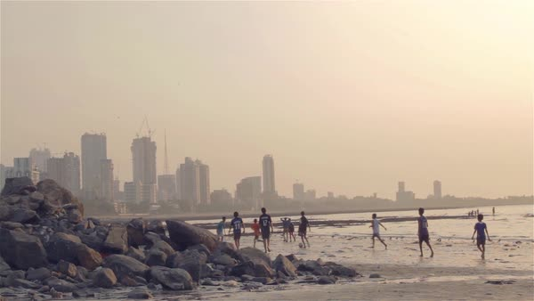Children playing near the sea. (Mumbai, India) Royalty-free stock video