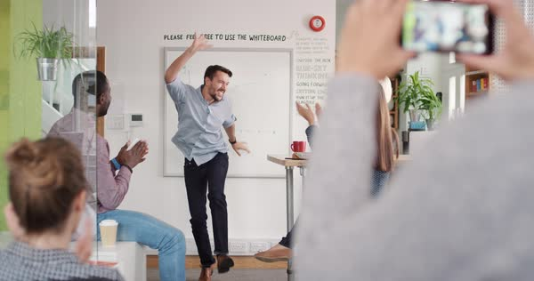 Crazy happy businessman dancing doing victory dance in team meeting celebrating success achievement Royalty-free stock video