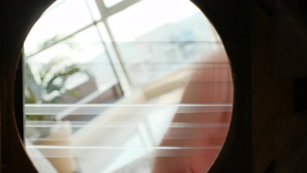 Close-up of man's hands playing classical guitar, sound hole perspective  stock footage