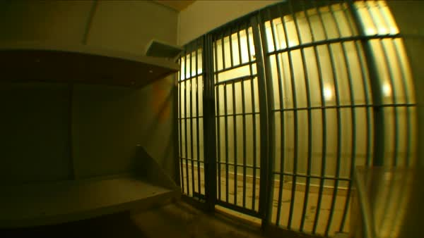 Jail cell door closing with the point of view form inside the cell  stock  footage