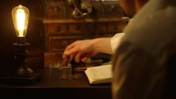 Medium closeup of man sitting at desk Royalty-free stock video