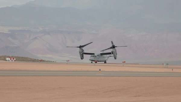 Aircraft V-22 Osprey VTOL short takeoff hover mode doing vertical takeoff and landing video. Used by USAF, Marines, Navy and NATO allies for transportation and troop movement in Iraq and Afghanistan and worldwide. Royalty-free stock video