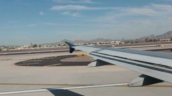 Passenger airline aircraft runway takeoff flight Phoenix Arizona. Passenger airline takeoff and flight from Phoenix Arizona. Royalty-free stock video