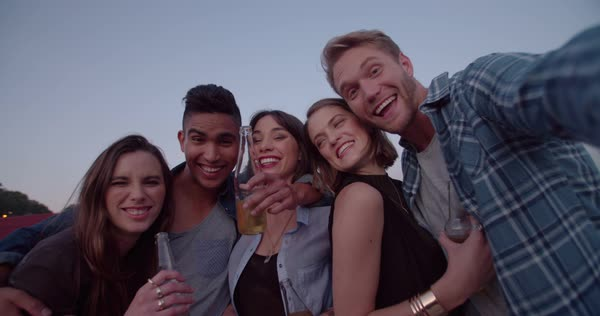 Group Of Hipster Teen Friends Making Smiley Faces While Taking A