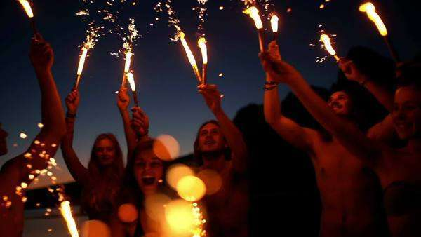 Friends with sparklers dancing in slow motion Royalty-free stock video