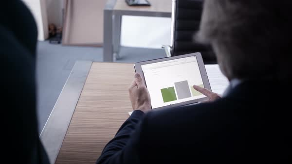 Graph information on tablet in meeting Royalty-free stock video
