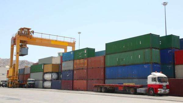 loading of containers with cargo to trucks in seaport Royalty-free stock video