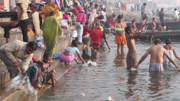 People Taking A Holy Bath In The Ganges River Varanasi