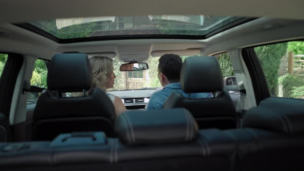 MS POV SELECTIVE FOCUS Mature couple driving in car / Dinton, Wiltshire,  England, UK stock footage