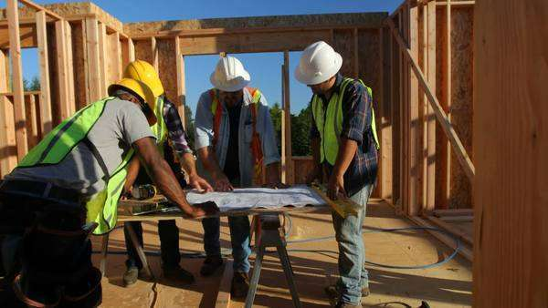 Group of construction workers look at plans Royalty-free stock video