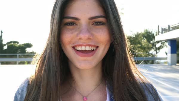 Portrait of a young woman laughing in a parking lot Royalty-free stock video