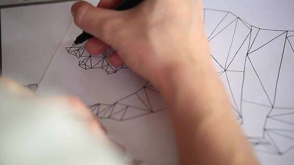 Close-up of a man drawing a sketch of an abstract bear Royalty-free stock video
