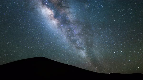 Milky way over a sacred summit on Mauna Kea timelapse Royalty-free stock video