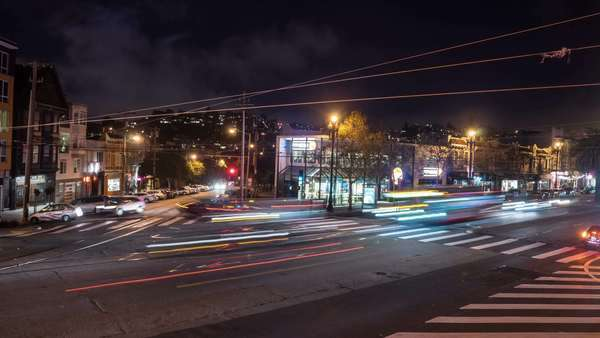 San Francisco's historic Castro District timelapse with fast moving traffic and people at night Royalty-free stock video