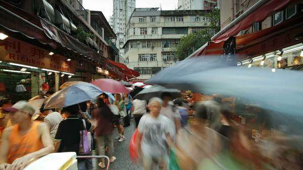 Shoppers browse the traditional Chinese Stalls in Wanchai market, Hong Kong Island, Hong Kong, China, Timelapse Royalty-free stock video