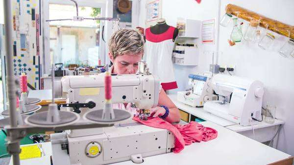 Tailor Behind Sewing Machine Working Professional Sewing Machine In Best Tailor Sewing Machine