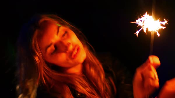 Hand-held shot of a woman dancing with sparklers Royalty-free stock video