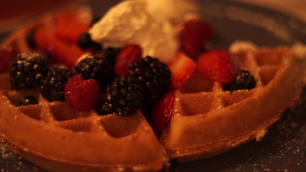 Hand-held shot of a person taking a piece of waffle Royalty-free stock video