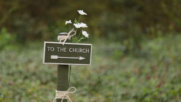 To the church sign, with flowers attached Royalty-free stock video