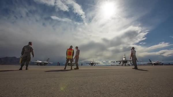 American F-16 fighters taxi and takeoff from the runway in these well  produced shots  stock footage