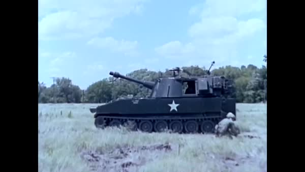 The 105mm Howitzer M 108 self propelled is fired from a tank  stock footage