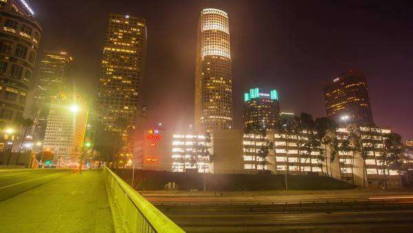 DOWNTOWN, LOS ANGELES, CALIFORNIA, USA - 10 OCTOBER 2014, City traffic panning timelapse in downtown Los Angeles at night. Royalty-free stock video