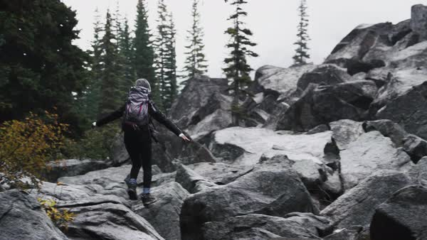 Back view of a woman hiking Royalty-free stock video