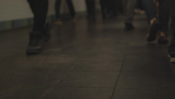 Point-of view shot of walking people legs through a subway tunnel Royalty-free stock video