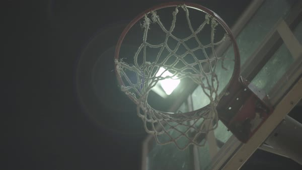 Hand-held shot of a ball being thrown into a basket Royalty-free stock video