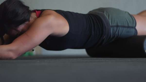 Low angle of female athlete on foam roller Royalty-free stock video