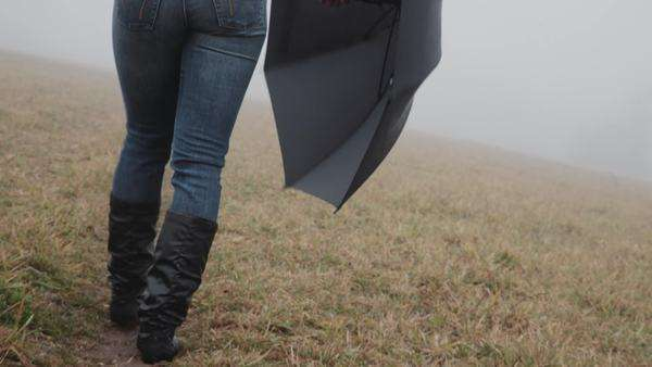 Medium shot of woman walking in a foggy field Royalty-free stock video