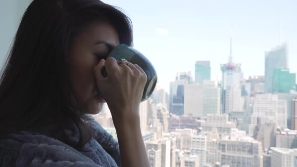 Close-up shot of a woman enjoying the view from her room Royalty-free stock video
