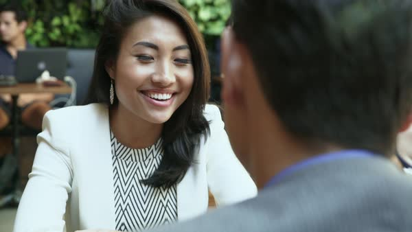 Medium close-up shot of a woman talking to a man Royalty-free stock video