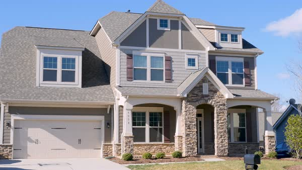 wide establishing shot of a typical middle class home in a suburban