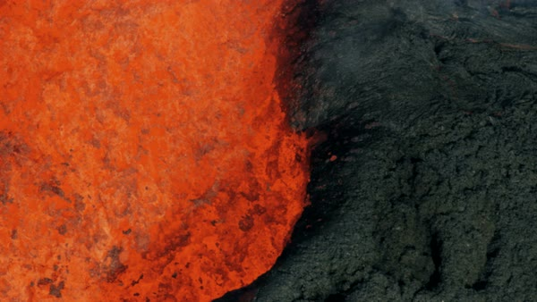 Aerial view of boiling exploding magma a powerful active volcano a natural  seismic volcanic event erupting red hot lava from within the earth stock