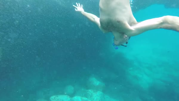 Hand-held shot of a diver swimming underwater Royalty-free stock video