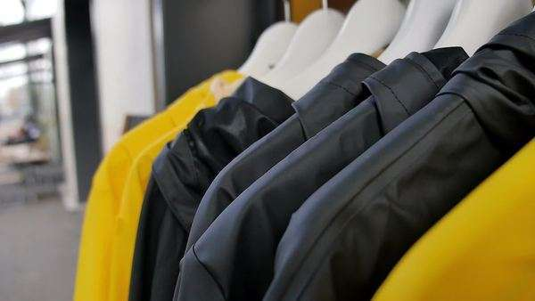 Raincoats on a rack outside a shop in Zurich Royalty-free stock video
