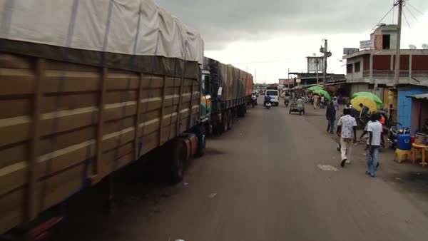 Wide shot of traffic at a market in Africa Rights-managed stock video