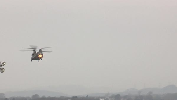 Wide shot of a flying transport helicopter Rights-managed stock video