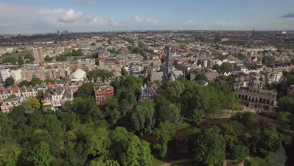Aerial panoramic view of center of Amsterdam against blue sky with clouds at summer, Netherlands Royalty-free stock video