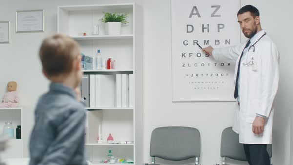 Young Boy is Checking His Eyesight in a Doctor's Office. Royalty-free stock video