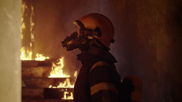Portrait of a firefighter inspecting burning building Royalty-free stock video