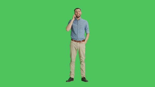 Long shot if a handsome man talking on a headset  Shot on green screen  background  stock footage