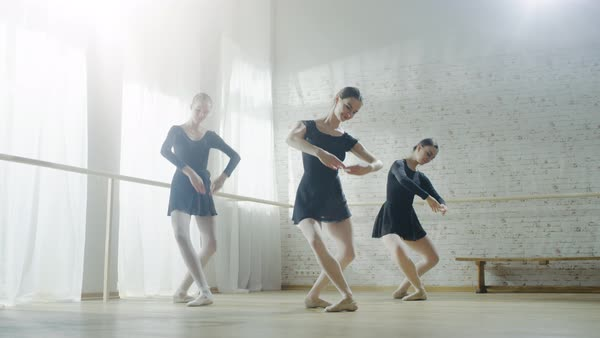 Three young and graceful ballerinas practicing their dance Royalty-free stock video
