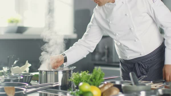 Chef Stirs Soup or Sauce in a Saucepan in Modern Kitchen. Royalty-free stock video