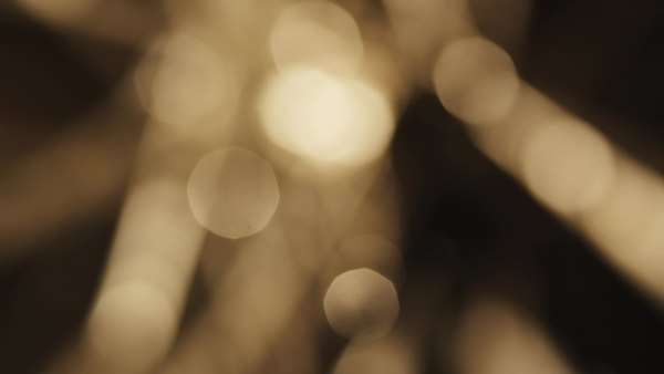 Beautiful bokeh of golden rotating lights Royalty-free stock video