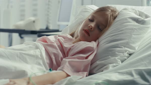 Cute Little Sick Girl Sleeps On A Bed In The Childrenu0027s Hospital   Stock  Video Footage   Dissolve